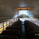 Inside the bus, image taken from rear towards front.